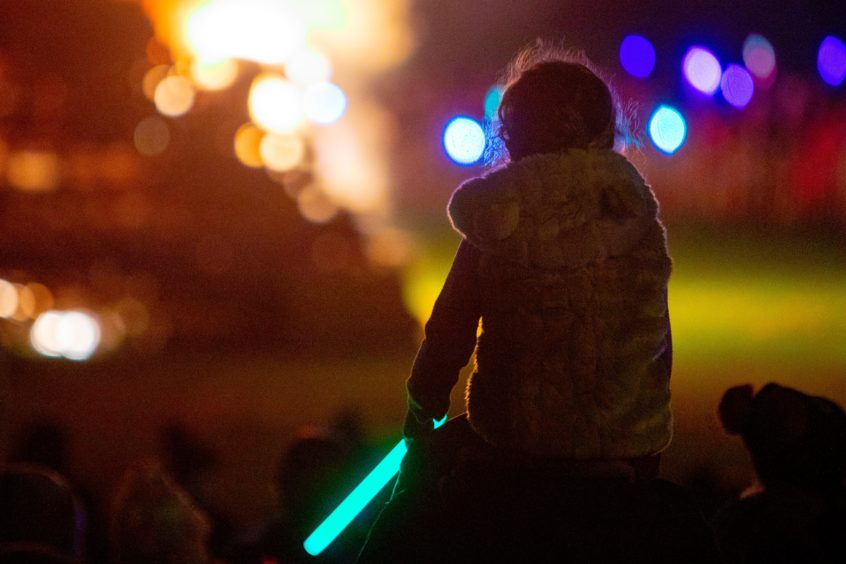 A youngster watches the bonfire light up in Burntisland.