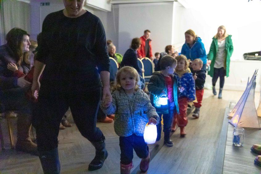 The lantern parade begins.