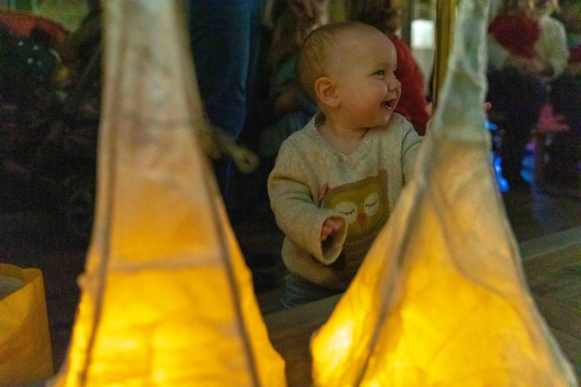 Baby Harriet Bowyer (11mth) is excited with the lanterns.