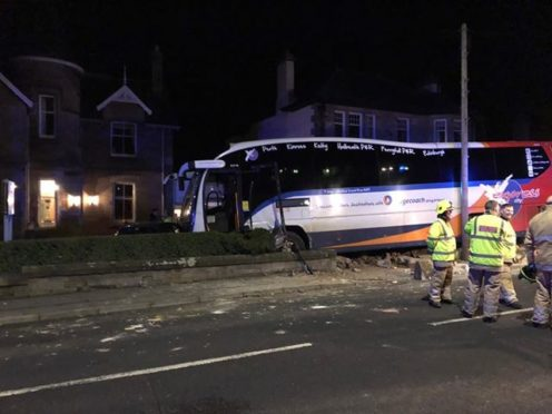Victoria Elrick and daughter Lucy were watching television when the bus smashed into their garden
