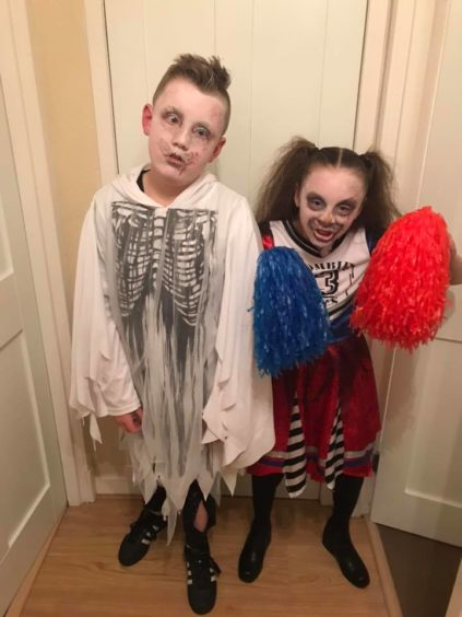 "Dawn Slane sent in this photo of a zombie and a ""dead cheerleader""."