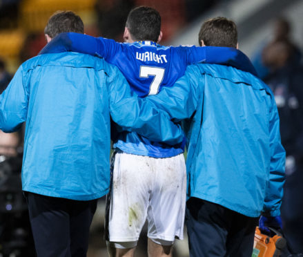 Drey Wright is helped off against Kilmarnock.