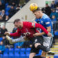 Jason Kerr battles with Kris Boyd.