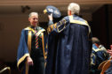 Peter Tatchell getting his honorary degree.
