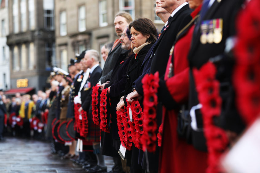 The Lord Provost, MSPs, local councillors and army personnel line up in wait to lay their wreaths in Dundee.