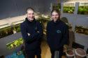 Rowan Woods and James Richmond in their shop.