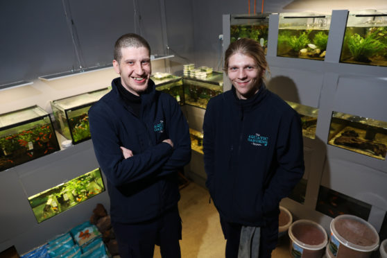 Rowan Woods and James Richmond in their shop.