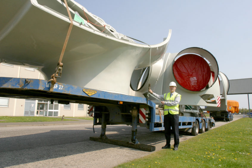 Parts of a wind turbine in the process of installation at Michelin Dundee, with engineering manager Bryan Bennett.
