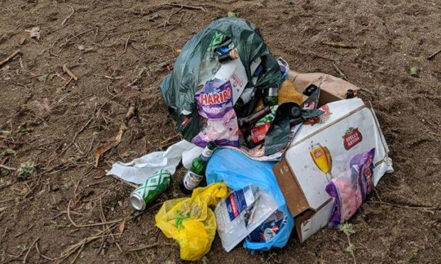 Litter tidied up from a wild camp site near Blair Atholl.