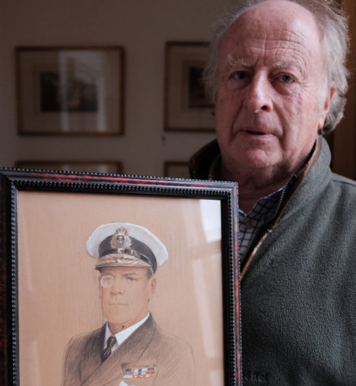Michael Wemyss with a portrait of his great great uncle, Rosslyn Wemyss.