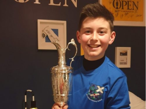 Joshua with the famous Claret Jug.