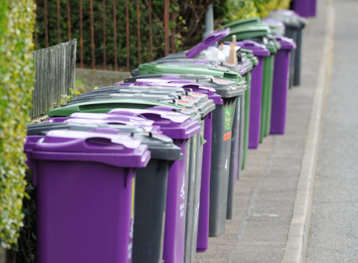 Kim Cessford - 09.04.14 - FOR FILE - pictured on Simpson/Balfour Place in Carnoustie are a long row of wheelie bins of various colours - could illustrate congestion on pavements caused by this type of council provided bin