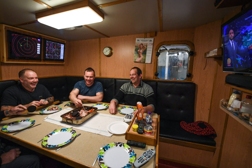 Crew members of the Radiant Star having some breakfast.