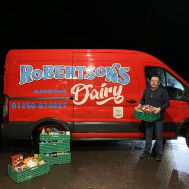 Gavin Robertson, owner of Robertson's Dairy, with some of the food bank donations.