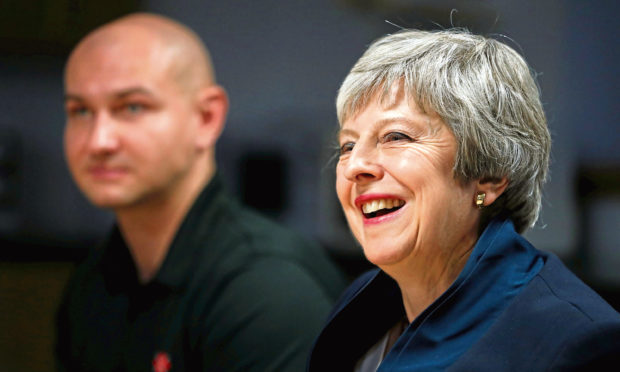 Prime Minister Theresa May during her visit to the Scottish Leather Group Limited, on November 28, 2018 in Bridge of Weir, Scotland.