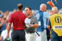 CARNOUSTIE, SCOTLAND - JULY 22:  Francesco Molinari of Italy shakes hands with his playing partner Tiger Woods of the United States during the final round of the 147th Open Championship at Carnoustie Golf Club on July 22, 2018 in Carnoustie, Scotland.  (Photo by David Cannon/Getty Images)
