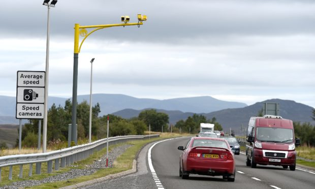 Average Speed Cameras and signage on the A9 over Drumochter south of Dalwhinnie close to the Highland Council boundary with Perth and Kinross.