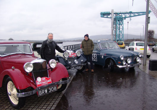 Bailie Denis Agnew of West Dunbartonshire Council (left) and UK coordinator Douglas Anderson with two classic Rileys and a Volvo Amazon