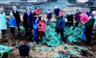 Volunteers filled a skip with litter and fishing debris from the beach near Crail