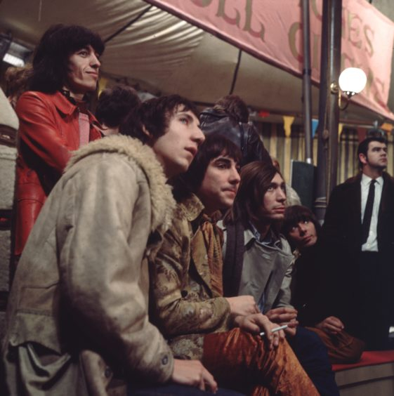 10th December 1968:  Members of the Who and the Rolling Stones, during the making of the Rolling Stones Rock and Roll Circus, (from left) Pete Townshend, Keith Moon  and Charlie Watts. The Rolling Stones bassist, Bill Wyman, is stood behind them.