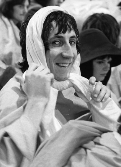 1968:  Pete Townshend, songwriter and guitarist with British rock group The Who, prepares his costume .