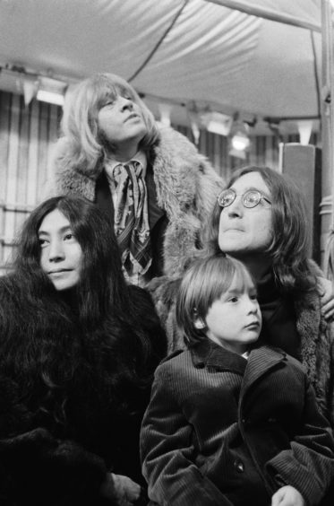 Brian Jones, Yoko Ono, John Lennon with his son Julian gather at Internel Studios in Stonebridge Park, Wembley, for the recording of a tv show planned by the Rolling Stones