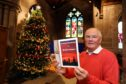 Archie Milne who is delighted with the interest in the new book about the stained glass windows.