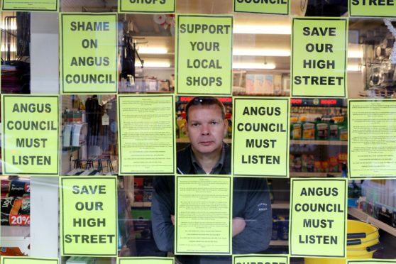 Brechin hardware store owner Bruce Robertson is one of those making clear his opposition to Angus Council's parking charges.