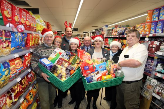 Davie Paton, Norman Fox, Gavin Wilson and Kirsty MacDonald collectded the latest odnation from Sandra West ,Lorraine Doig,  Emma Duncan and Michael Lomax at the Co-op