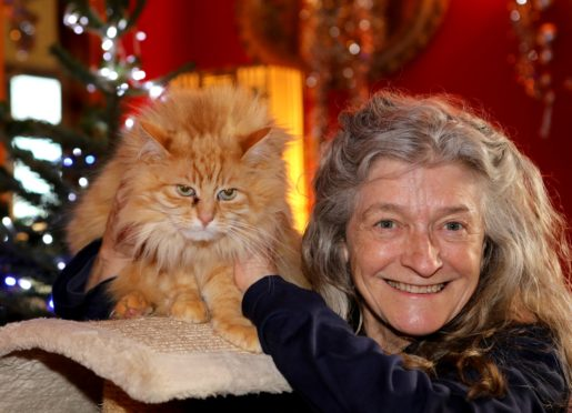 """Elle Stirling from Kinettles near Forfar with one of her cats """"Squirrell""""."""