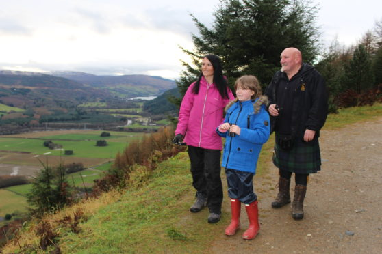 Gayle Ritchie, Deia Wilkinson and Highland Safari Winter Watch guide Jim Scotland gaze out over Strathtay Valley.
