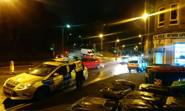 Officers seen 'chasing man' as seven police cars attend