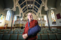 Rev Martin Fair back in action after almost losing his arm in a freak accident.