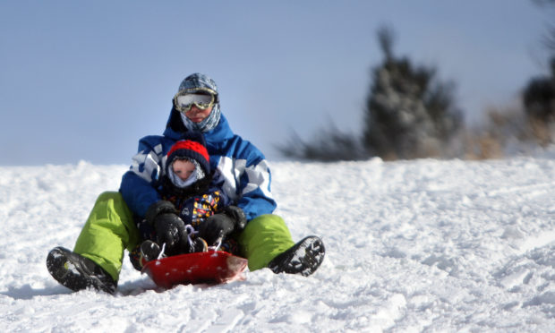 Kevin and Ben Trueland sledging near Balmossie Road. Kris Miller/DCT Media