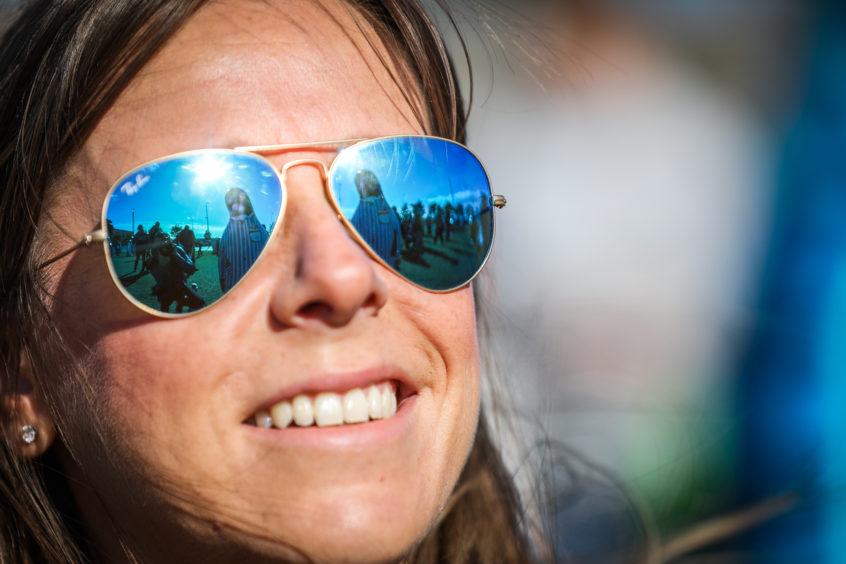 Penguins reflected in Lydia Cockers' sunglasses. Kris Miller/DCT Media