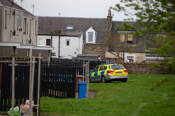 Police in attendance at an address at Miller Street, Kirkcaldy