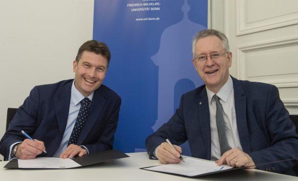 Professor Brad MacKay left) and Professor Dr HC Michael Hoch sign the agreement
