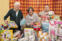 Irene Gillies MBE, Kathleen Strachan and Paul Cassidy from Tescos in Brechin with some of the toys.