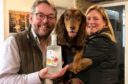 Persie distillery managing director Simon Fairclough at the Spaniel Gin launch with Daniel the spaniel and gin and dog fan Jennifer Elder from Forfar.