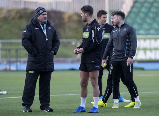 Glasgow Warriors head coach Dave Rennie speaks to Adam Hastings during training at Scotstoun.
