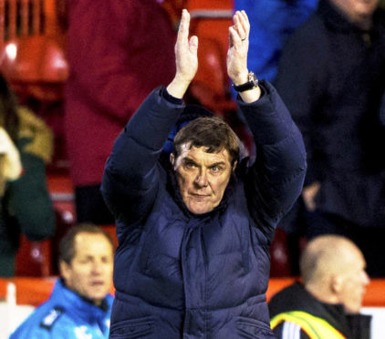 Tommy Wright applauds the Saints fans at full-time.