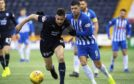 Dundee's Cammy Kerr (L) drives away from Kilmarnock's Jordan Jones.