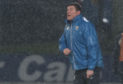 A drenched Tommy Wright urges on his players.