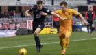 Dundee's Cammy Kerr (left) battles with Livingston's Nicky Cadden.