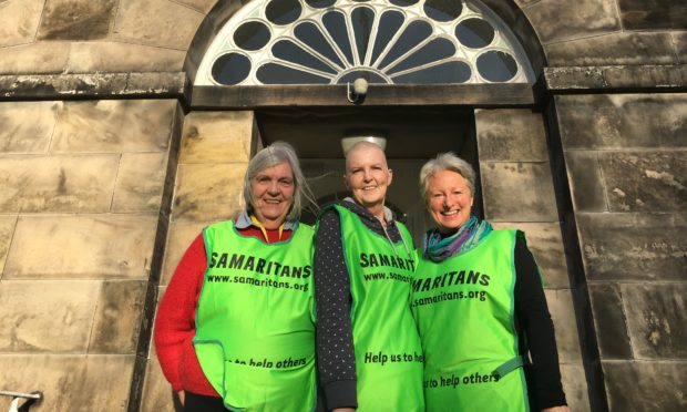 Perth director Maggie Taylor (centre) with Samaritans volunteers