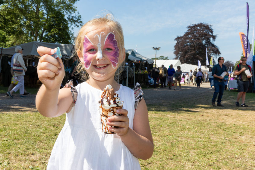 Ava Flett from Perth enjoys an ice cream at Scone Game Fair. Steven Brown/DCT Media
