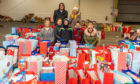 Lee Miller, Amy Walker, Jenni Newlands, Kate Hope, Billy Hope, Hannah Miller and Callie McFarlane with the donated gifts.