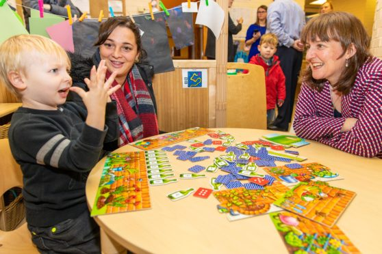 Ollie Mack, 4, of Inverkeithing, with supply early years officer Elizabeth Souter and Maree Todd MSP, right.