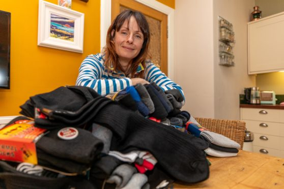 Jennifer Jones, from St Monans, is collecting unwanted Christmas sock gifts for the homeless.