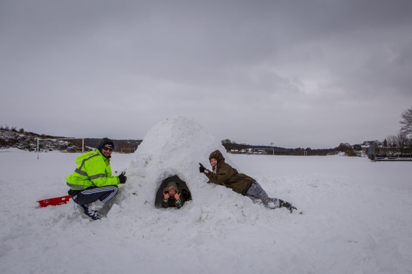 Tyler Bray, Phillip Bray and Amie Dorman built an igloo. Steven Brown/DCT Media